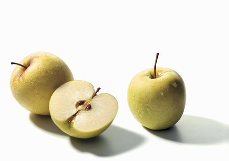 two and a half: Two whole green apples and half an apple