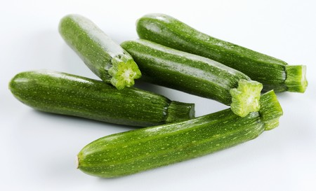 courgettes: Courgettes on white surface