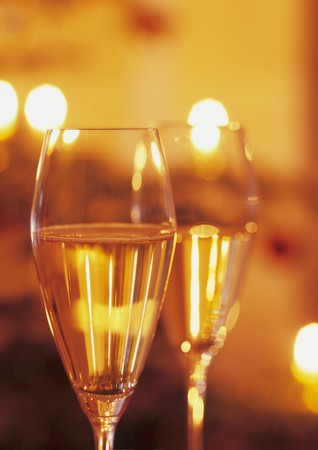 champers: Two glasses of sparkling wine in subdued light