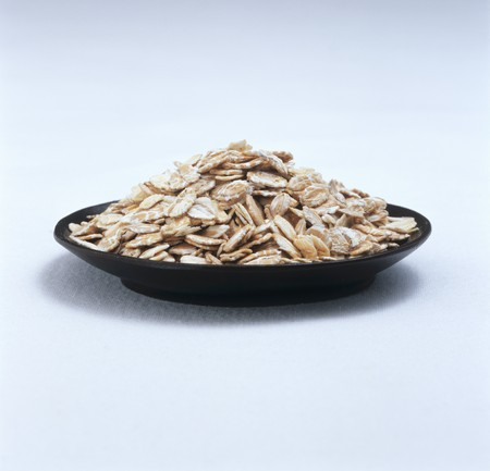 rolled oats: Rolled oats on black plate