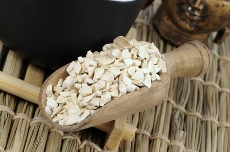 Angelica root (Angelica dahurica) in a wooden scoop