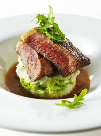 roquette: Beef steak on mashed potato and rocket