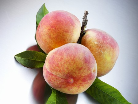 florentine: Yellow Florentine peaches with leaves