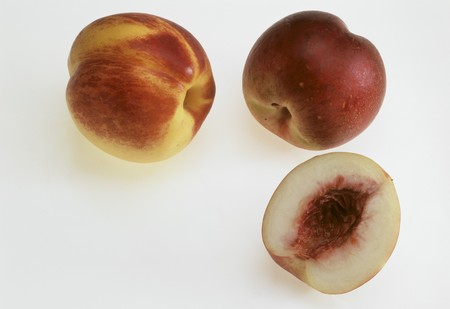 two and a half: Two whole nectarines and half of a nectarine