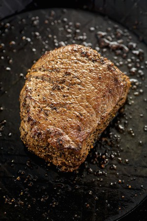 peppered: Fried peppered steak in frying pan