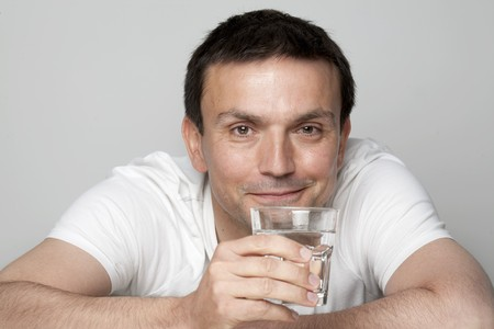 30 to 35 year olds: Man holding glass of water