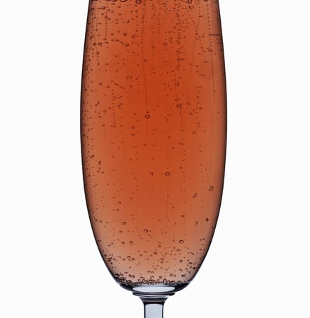 champers: A glass of ros� sparkling wine (detail)