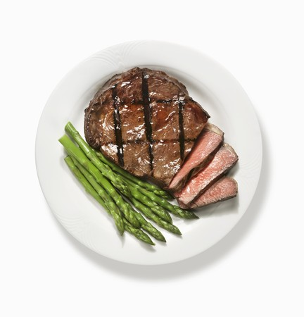 Partially Sliced Grilled Steak with Asparagus; From Above LANG_EVOIMAGES