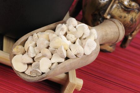 nature cure: Pinellia tubers in a wooden scoop