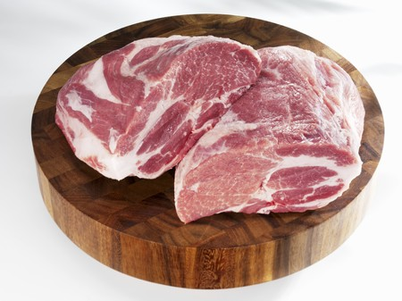Raw pork (neck) on chopping board