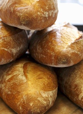several breads: Freshly Baked Parisienne Bread Loaves