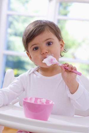 0 1 year: Little girl eating