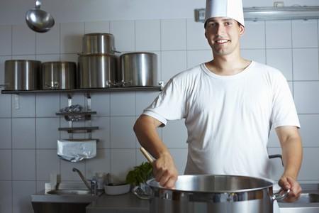 stirring: Chef stirring a pan on range LANG_EVOIMAGES
