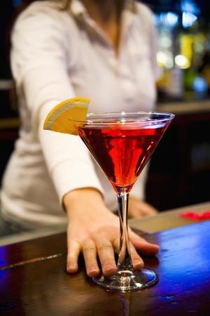 barkeep: Bartender Serving Cosmopolitan