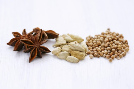 coriander seeds: Star anise, cardamom pods and coriander seeds