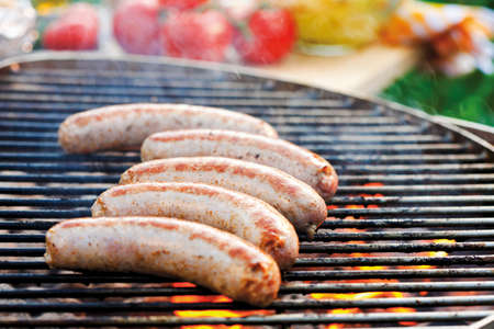 qs: Sausages on barbecue rack