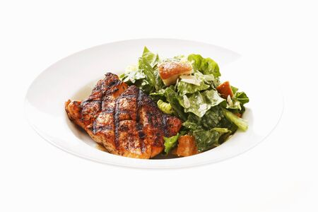 caesar salad: Caesar salad with grilled salmon