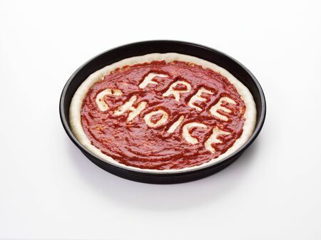 pizza base: Pizza base with the words Free Choice in tomato sauce