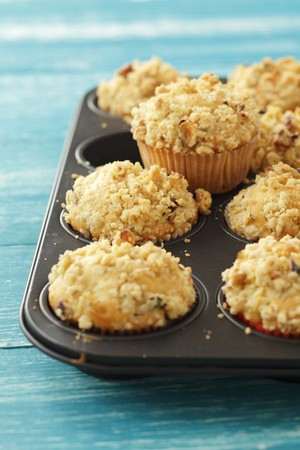pip: Apple muffins topped with nut crumble in a muffin tin