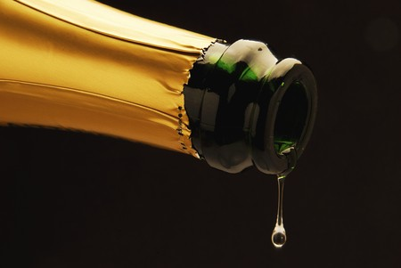 champers: Sparkling wine dripping out of bottle