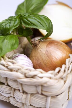 close up of onions in a basket: Garlic, onions and basil in basket LANG_EVOIMAGES