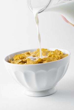 cornflakes: Pouring milk on cornflakes