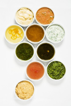 Assorted salad dressings in small dishes from above