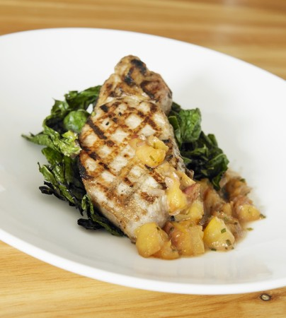 qs: Grilled Pork Chop with Peach Chutney and Greens LANG_EVOIMAGES