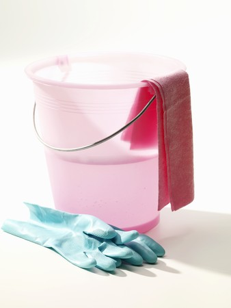 cleansed: Pink cleaning bucket with rubber gloves