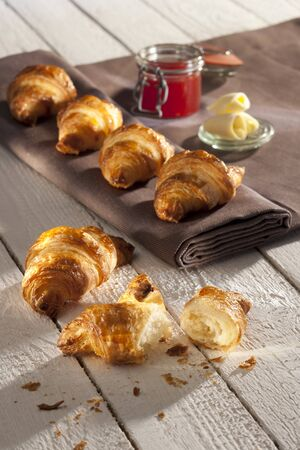curls: Croissants, strawberry jam and butter curls LANG_EVOIMAGES