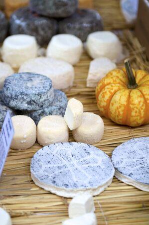 cheeses: Various cheeses on straw mat