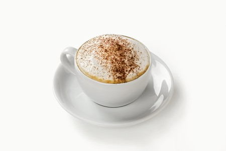 hot coffees: Cappuccino in cup and saucer