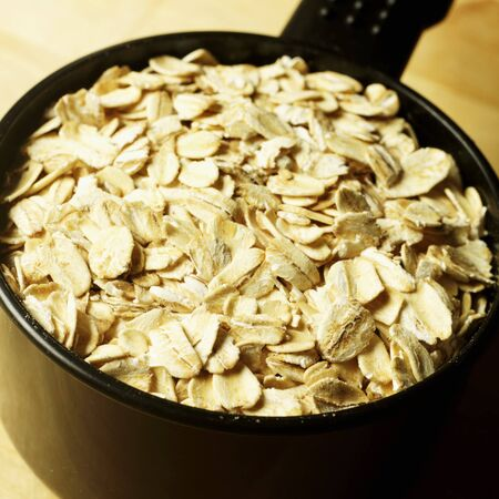 rolled oats: Rolled Oats in a Measuring Cup