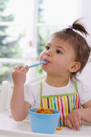 0 1 year: Girl eating pasta with bolognese sauce