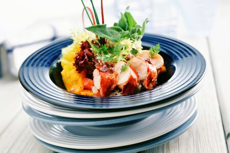 lobster tail: Salad leaves with lobster tail and mango