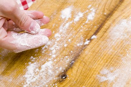 worktops: Dusting a work surface with flour