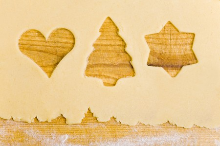 biscuit dough: Biscuit dough with the shapes of cut-out biscuits