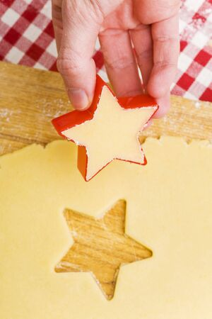 biscuit dough: Cutting biscuits out of biscuit dough