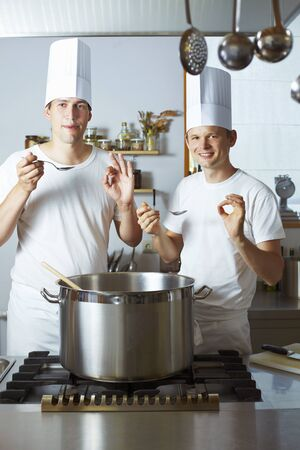 culinary skills: Two chefs satisfied with the results of their culinary skills