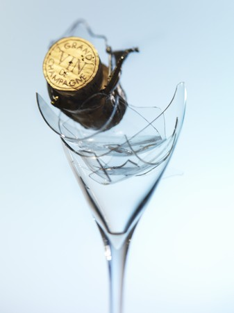 champers: Champagne cork on broken champagne glass LANG_EVOIMAGES
