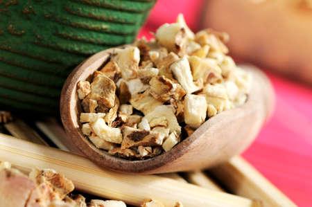 wooden scoop: Dried anemarrhena root in wooden scoop
