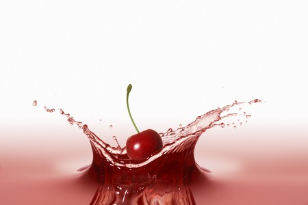 squirted: A cherry falling into red juice LANG_EVOIMAGES