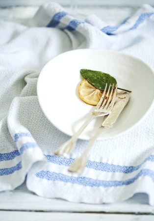 leavings: Fish knife and fork, lemon and sage