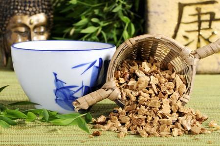 chuan: Cup of tea and dried pagoda tree fruit (Chuan Lian Zi, China)