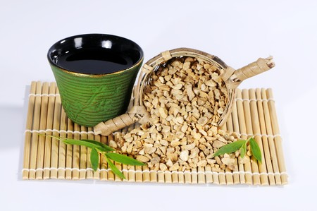 nature cure: Dried water plantain root and bowl of tea (Ze Xie, China)