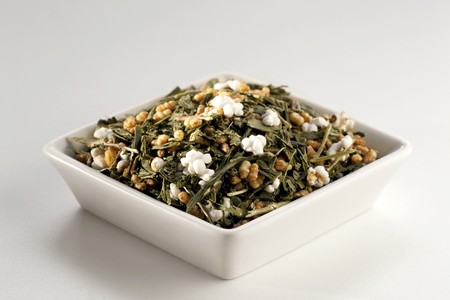gen: Japanese Gen Mai Cha Loose Green Tea in a White Dish; White Background