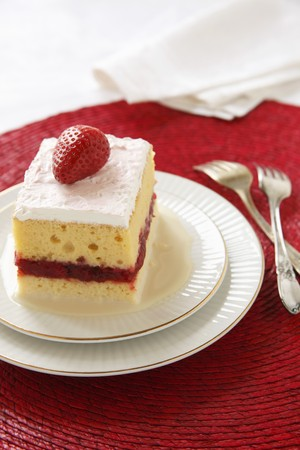 rimmed: Piece of Tres Leches Cake with a Strawberry Layer; Two Forks LANG_EVOIMAGES