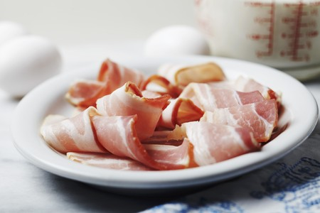 uncooked bacon: Breakfast Ingredients; Strips of Uncooked Bacon, Eggs and Milk