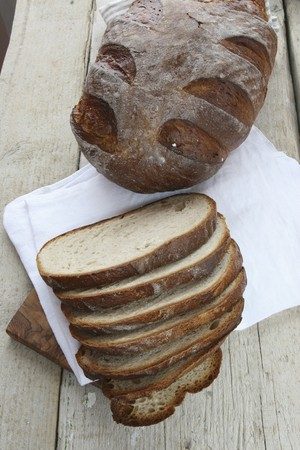 woodfired: Rustic bread baked in a wood-fired oven, whole loaf and sliced