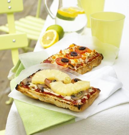 several breads: Two different focaccia pizzas